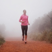 woman running to avoid holiday weight gain