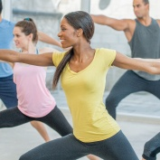 gym members practicing yoga for weight loss