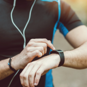 man using cal fit rewards program on fitness wearable